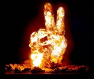 Image of a hand forming a peace sign on fire.